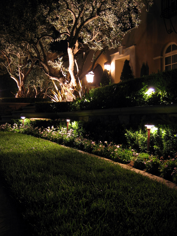 Landscaping lighting js goode landscaping low voltage lighting can turn your home and yard into a warm inviting place the dramatic effects from outdoor lighting are startling aloadofball